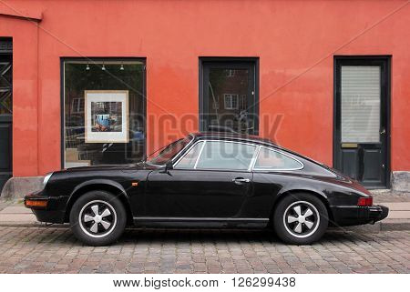 COPENHAGEN - MAY 19 2012: Vintage Porsche 911 at the Christianshavn district in Copenhagen. Porsche 911 is one of the most iconic and recognized sports cars in the world May 19 2012