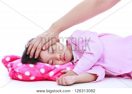 Mother checking temperature of sick daughter by hand. Adorable asian child in pink pajamas sleeping peacefully isolated on white background.