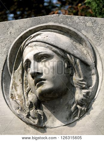 Stone Sculpture Of A Grieving Woman