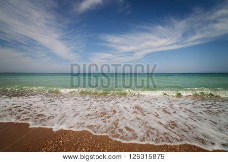 Landscape. Oceanside under blue sky with clouds