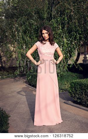 Young Beautiful Stylish Girl Posing In Long Pink Dress. Outdoor Summer Portrait Of Young Classy Woma