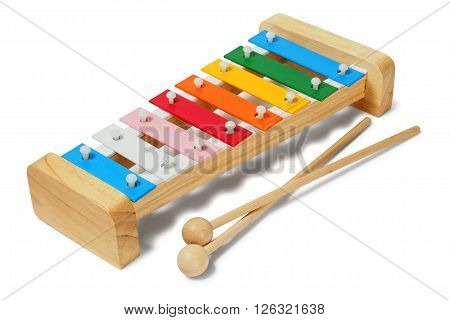 Rainbow xylophone and mallets on white background