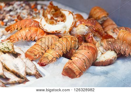 Langoustines at the counter in a street cafe