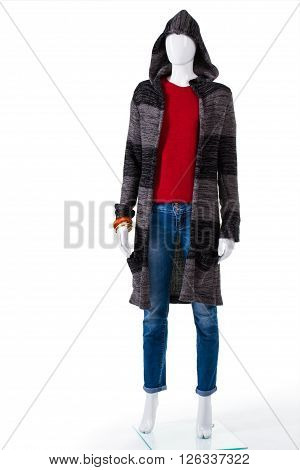 Striped sweater coat with hood. Female mannequin in sweater coat. Lady's soft outerwear on display. Clothes for dry cool weather.