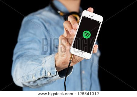 WROCLAW, POLAND - APRIL 12, 2016: Apple iPhone SE smartphone with music streaming app Spotify on screen