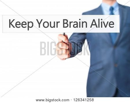 Keep Your Brain Alive - Businessman Hand Holding Sign