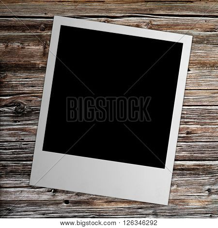 photo polaroide isolated on the wood backgrounds