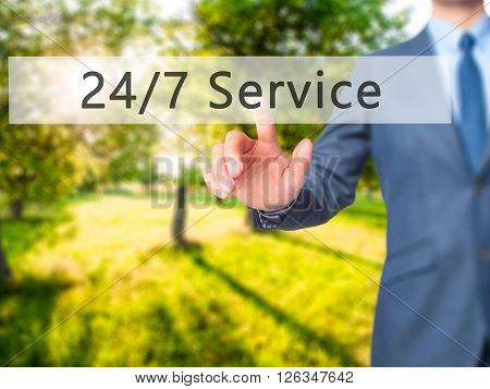 24/7 Service - Businessman Hand Pressing Button On Touch Screen Interface.