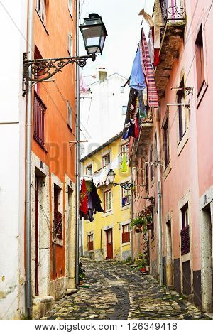 A narrow street in Alfama district in Lisbon Portugal