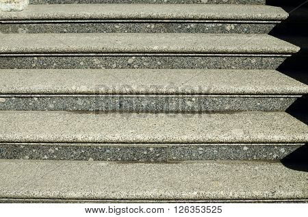 Sturdy granite stairs.By it one ascends to the door of the building.