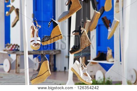 sandals for women Wedge and others hanging on the ropes