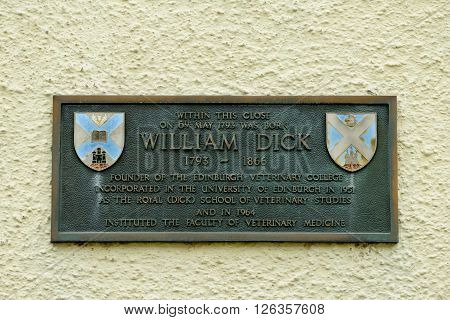 EDINBURGH SCOTLAND - APRIL 16 2016: Memorial plaque in Whitehorse Close in the Cannogate on the Royal Mile in Edinburgh. Birthplace of William Dick founder of the Royal Dick Veterinary School.