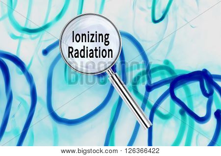 Magnifying lens over background with text Ionizing Radiation, with the long exposure lights visible in the background. 3d Rendering.