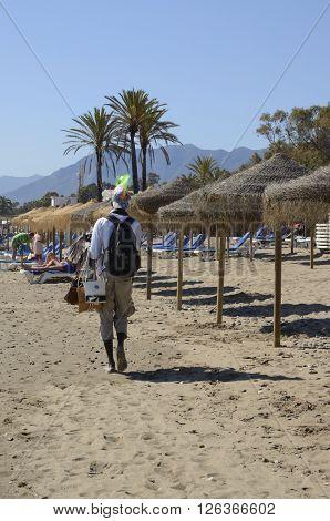 MARBELLA, SPAIN - APRIL 9, 2016: Man selling bags by the beach in Marbella Spain.