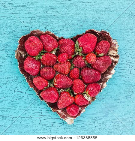 Fresh Strawberries In Heart Shape Plate On Blue Wooden Table. Top View, Copy Space. Strawberry Heart