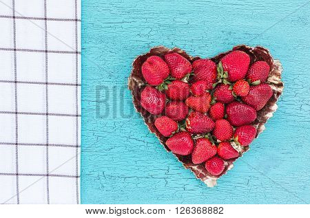 Fresh Strawberries In Plate On Blue Rustic Table. Top View, Copy Space. Strawberry Heart