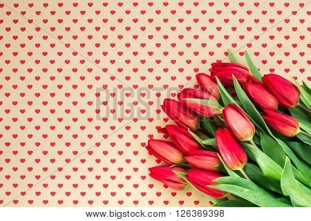 Bouquet Of Red Tulips On Hearts Background. Copy Space, Top View.