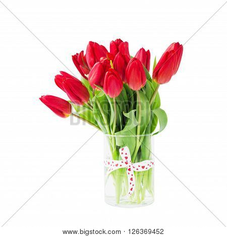 Red Tulips Bouquet In Vase Decorated With Ribbon. Isolated Over White Background