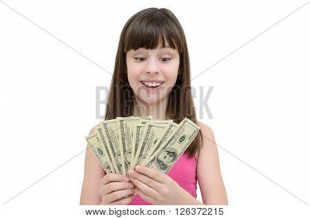 Girl In Amazement Holding Money On White Background
