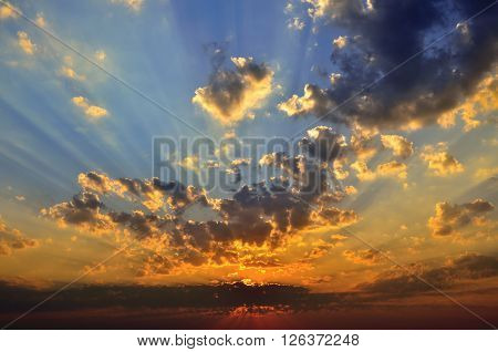Cloudy Sky In The Background Of The Rising Sun