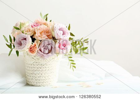 Bouquet Of Beautiful Roses On A Blue Wooden Table