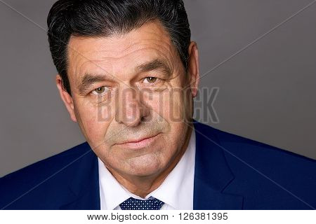 businessman at the age of 50 years old in a blue suit portrait
