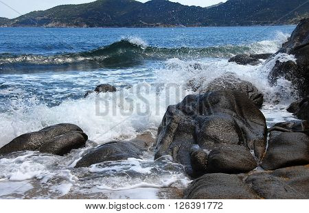 waves and stones at the blue Ionian sea seaside in Greece ** Note: Soft Focus at 100%, best at smaller sizes