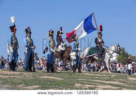 BAILEN SPAIN - october 5 2008: Taken in Bailen Jaen province during the commemoration of the anniversary of the battle of Bailen of 1808 Soldiers of the Napoleonic troops are positioned in the field of battle a soldier on horseback holding the flag french