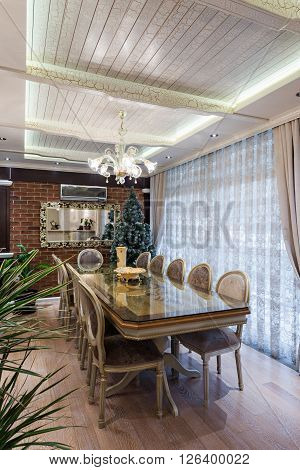 Specious classic dining room interior and Christmass tree