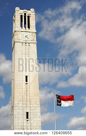 bell tower and North Carolina state flag