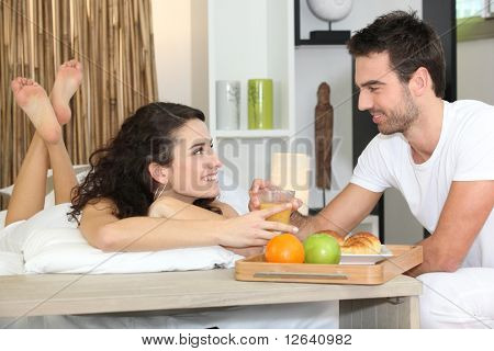 Loving couple at breakfast