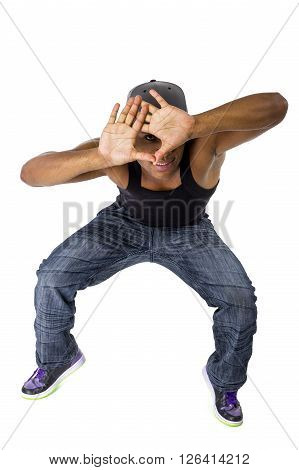 Fit urban dance teacher gesturing a frame like he is planning a choreography
