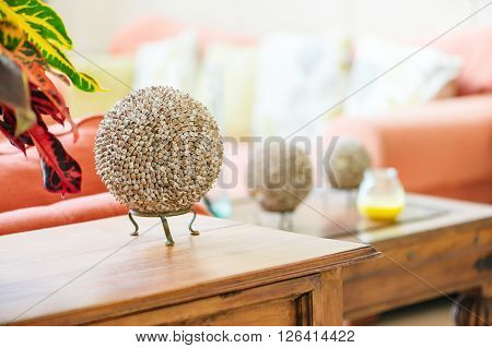 Modern home interior living room detail seashell balls on table top craft item object