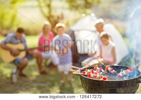 barbecue and family on camping in nature