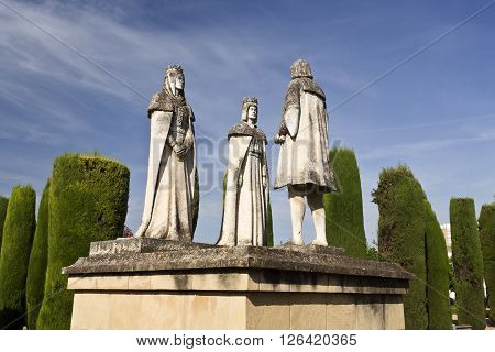 CORDOBA, SPAIN - September 10, 2015: Statues of the Catholic Monarchs (Ferdinand and Isabella) and Christopher Columbus in the gardens of the Alcazar of Cordoba, on September 10, 2015 in Cordoba, Spain
