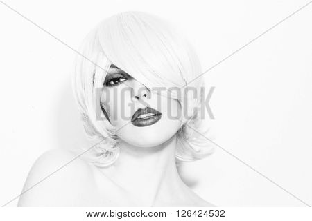 Black and white portrait of young beautiful woman with choppy lob with fringe and smoky eyes