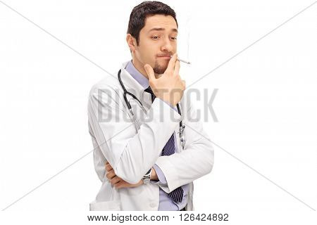 Careless doctor smoking a cigarette isolated on white background