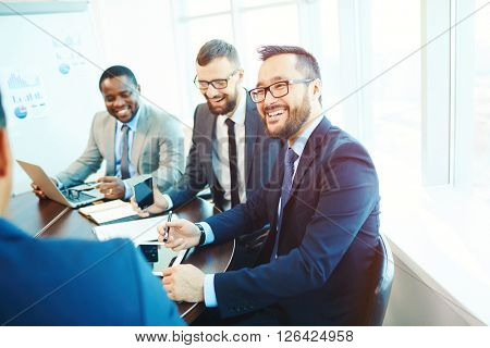 Businessmen laughing