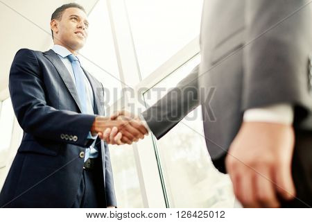 Shaking hands with partner