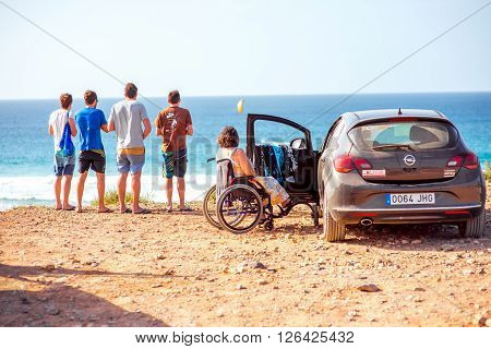 EL COTILLO, FUERTEVENTURA ISLAND, SPAIN - SIRCA JANUARY 2016: Group of people travel by car rented at Cicar company on Fuerteventura island. Cicar is very popular car rental company on Canary islands