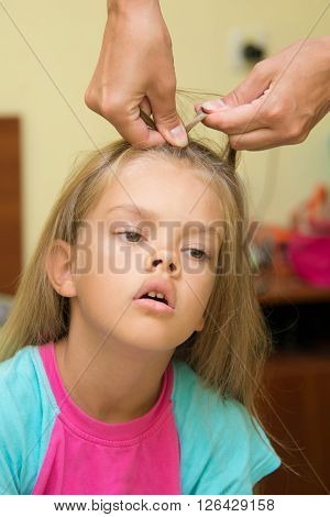 The girl with a tortured expression braided long hair poster