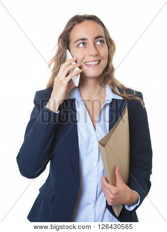 Blond businesswoman with blue eyes and blazer at phone on an isolated white background for cut out