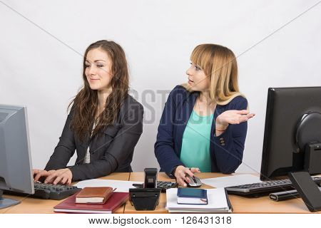 Office Worker With Indignation Looking At Quite A Colleague Sitting Next To A Computer