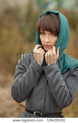 Beautiful stylish woman in grey coat outdoors