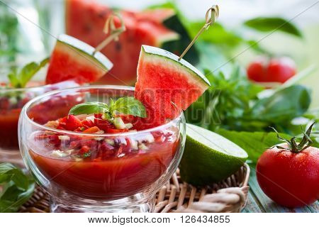 Watermelon tomato gazpacho in  glass bowls