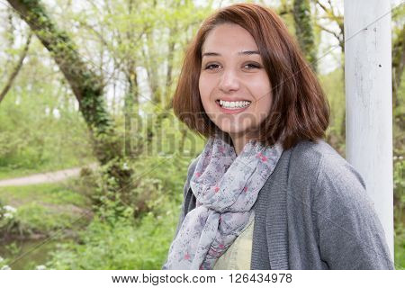 Cute And Confident Smiling Girl Looking At The Camera