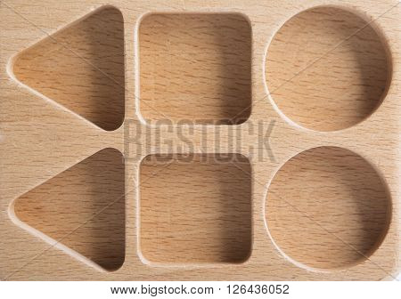 Baby Sorter With Geometric Figures From Wood On White Isolated