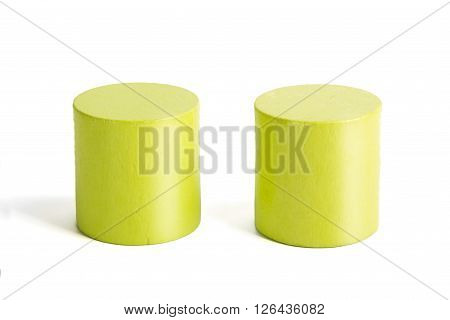 Wooden Color Green Cylinders On A White