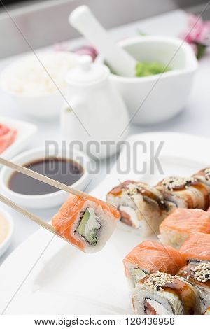 Salmon Sushi Roll In Chopsticks