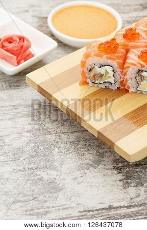 Japanese Cuisine. Sushi Roll With Wasabi And Ginger On A Rustic Table.